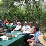 Many generous folks came together to provide valuable input for planning. Here, Dr. Tom Carr (in white hat in middle) chats with Dr. Ray Willis during one session outside of the cabin. Before it was over, other Carr family members, USFS personnel, preservation experts, vernacular craftsmen, historians, Boy Scouts, filmmakers and others pitched in.